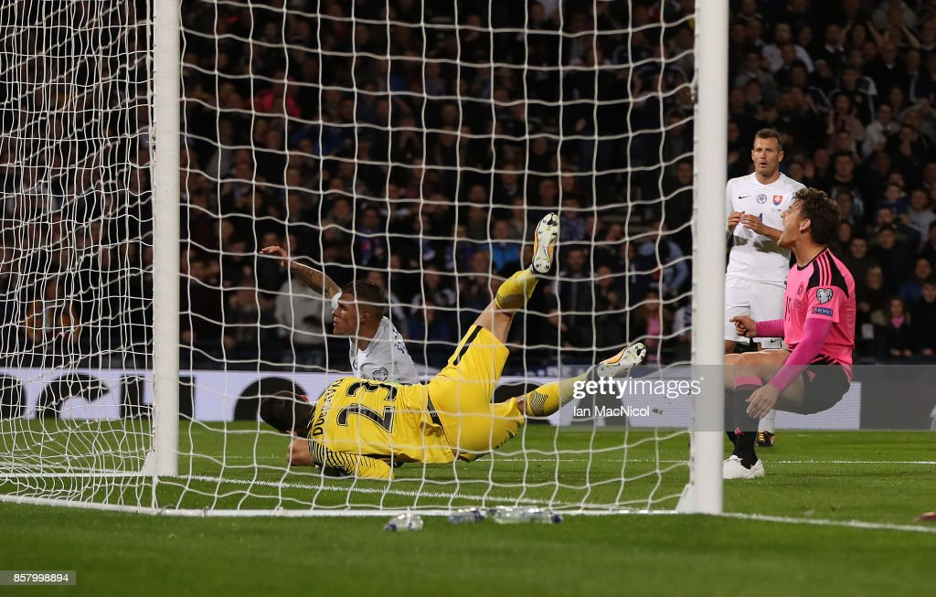 Chris Martin of Scotland celebrates as Martin Skrtel of Slovakia scores an own goal during the FIFA 2018 World Cup Qualifier between Scotland and Slovakia at Hampden Park on October 5, 2017 in Glasgow, Scotland.