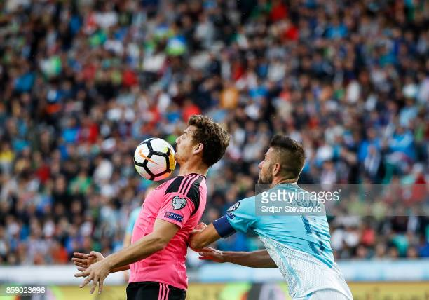 Chris Martin of Scotland in action against Bostjan Cesar of Slovenia during the FIFA 2018 World Cup Qualifier match between Slovenia and Scotland at...