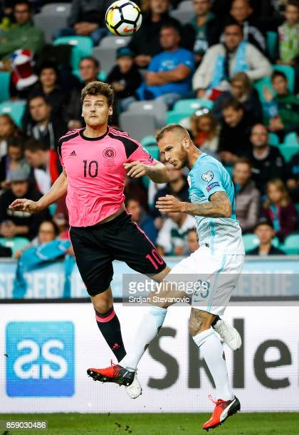 Chris Martin of Scotland jump for the ball against Aljaz Struna of Slovenia during the FIFA 2018 World Cup Qualifier match between Slovenia and...