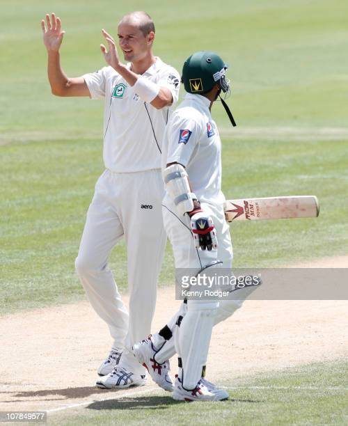New zealand invitation xi stock photos and pictures getty images chris martin of the new zealand invitation xi celebrates the wicket of tuufeeq umar of pakistan stopboris Image collections