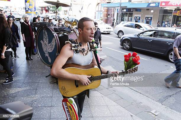 Chris Martin of the UK band Coldplay films a music clip on King Street in Newtown Sydney June 17 2014