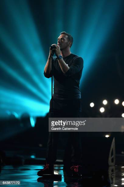 Chris Martin performs a tribute to George Michael on stage at The BRIT Awards 2017 at The O2 Arena on February 22 2017 in London England