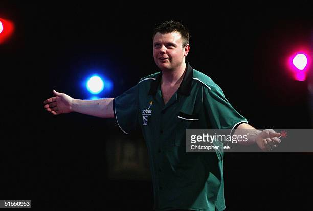 Chris Mason of England in action against Steve Beaton of England during the 2004 Skybet World Darts Grand Prix Quarter Final match at The CityWest...