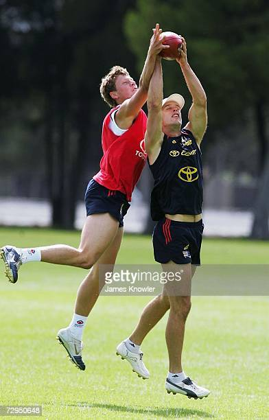 Chris Massie and Brad Ebert of the Crows compete for the ball during an Adelaide Crows AFL training session at Max Basheer Reserve on January 8 2007...