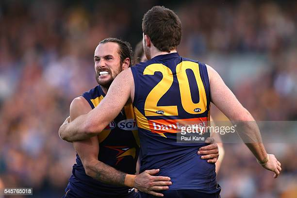Chris Masten of the Eagles celebrates a goal with Jeremy McGovern during the round 16 AFL match between the West Coast Eagles and the North Melbourne...