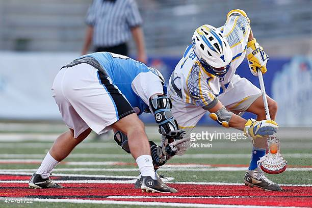 Chris Mattes of the Florida Launch beats Greg Puskuldjian of the Ohio Machine for a faceoff win during the game on May 24 2015 at Selby Stadium in...