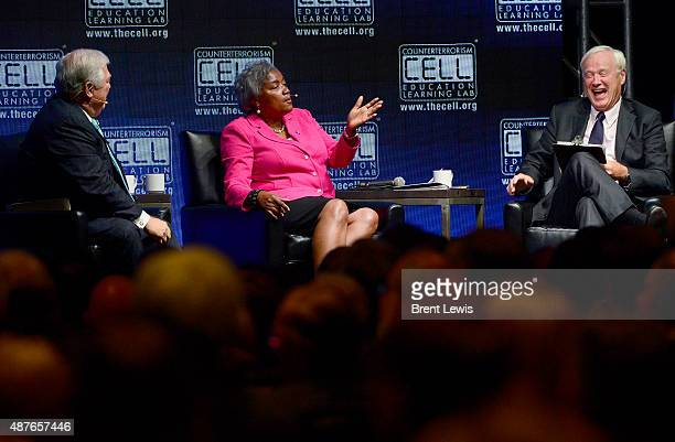 Chris Matthews laughs while Donna Brazile talks about the 2016 campaign during the Colorado Remembers 9/11 Commemoration and Event on September 10...