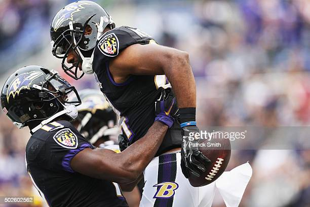 Chris Matthews of the Baltimore Ravens right celebrates with his teammate Kamar Aiken after scoring a touchdown against the Pittsburgh Steelers at MT...