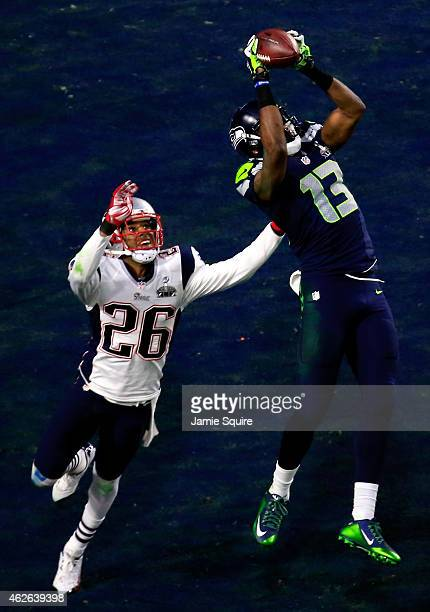 Chris Matthews of the Seattle Seahawks catches an 11 yard touchdown late in the second quarter against Logan Ryan of the New England Patriots during...