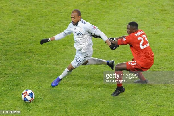 BMO FIELD TORONTO ONTARIO CANADA Chris Mavinga holds Teal Bunbury during 2019 MLS Regular Season match between Toronto FC and New England Revolution...