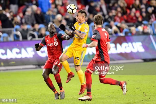Chris Mavinga of Toronto FC attempts to stop Eduardo Vargas of Tigres UANL during the CONCACAF Champions League Quarterfinal match between Toronto FC...
