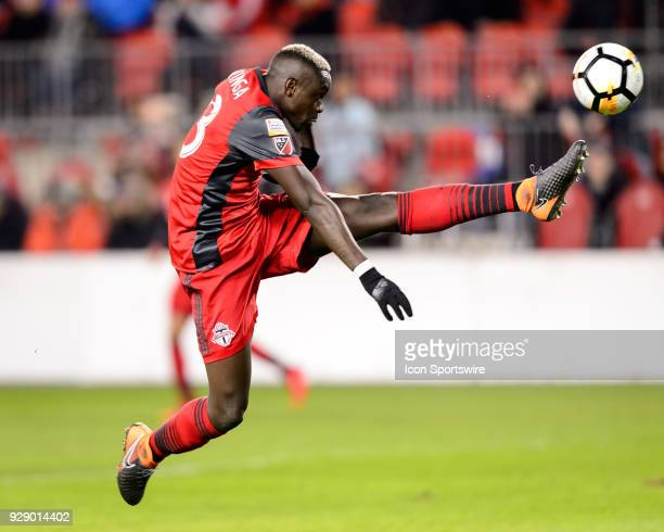Chris Mavinga of Toronto FC jumps in the air and stretches to reach the ball during the first half of the CONCACAF Champions League Quarterfinal...