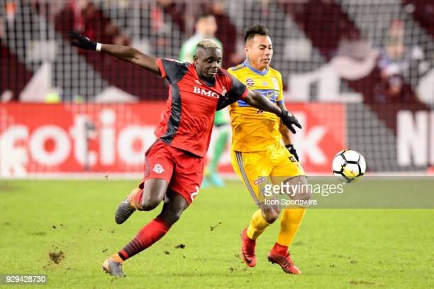 Chris Mavinga of Toronto FC stops Eduardo Vargas of Tigres UANL during the CONCACAF Champions League Quarterfinal match between Toronto FC and Tigres...