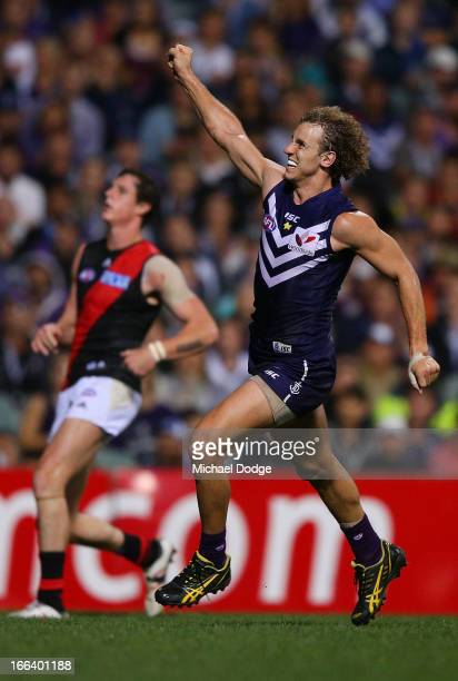 Chris Mayne of the Dockers celebrates a goal during the round three AFL match between the Fremantle Dockers and the Essendon Bombers at Patersons...