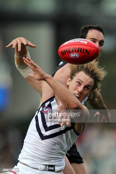 Chris Mayne of the Dockers competes for the ball with Matthew Broadbent of the Power during the round eight AFL match between the Port Adelaide Power...
