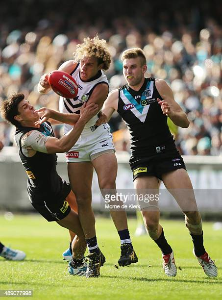Chris Mayne of the Dockers is tackled by Angus Monfries of the Power during the round eight AFL match between the Port Adelaide Power and Fremantle...