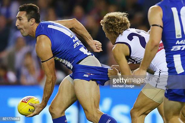 Chris Mayne of the Dockers tackles Michael Firrito of the Kangaroos during the Round 4 AFL match between North Melbourne v Fremantle at Etihad...