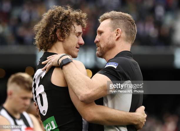 Chris Mayne of the Magpies and Nathan Buckley Senior Coach of the Magpies look dejected after the 2018 AFL Grand Final match between the Collingwood...