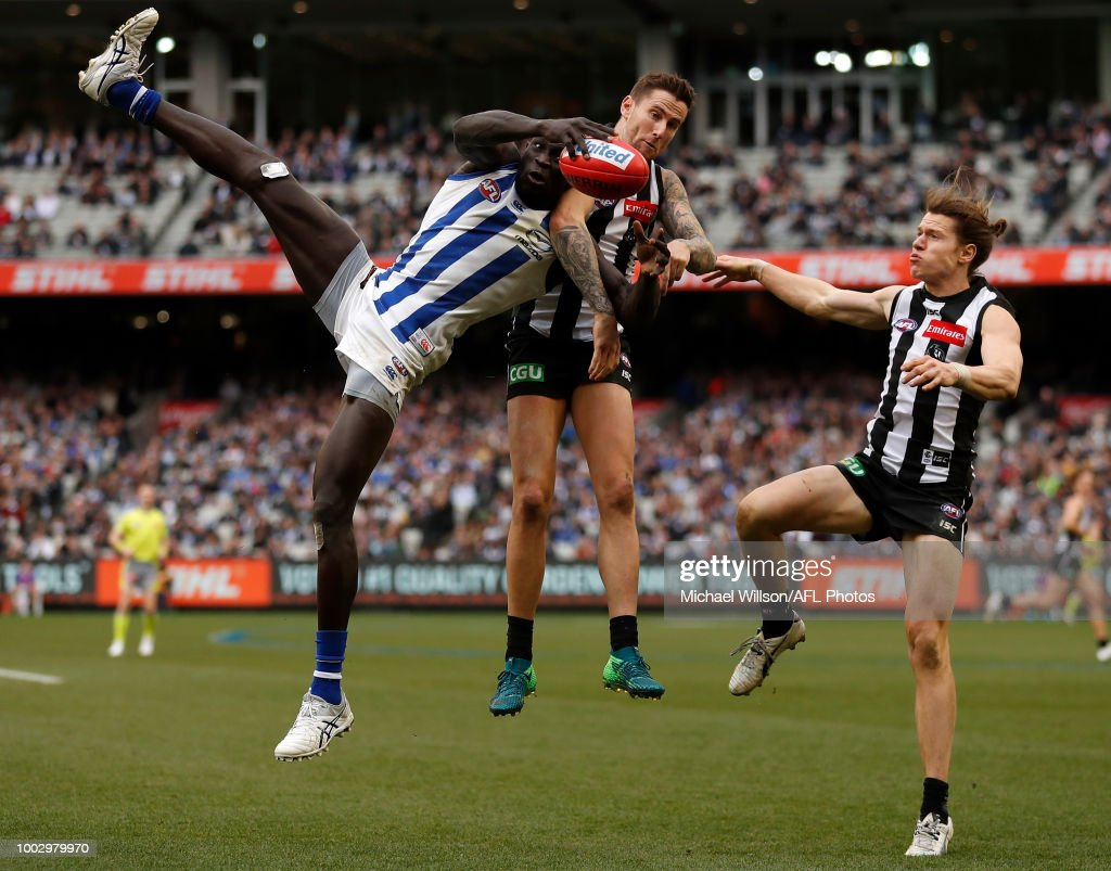 Chris Mayne of the Magpies is tackled by Kayne Turner of the Kangaroos during the 2018 AFL round 18 match between the Collingwood Magpies and the North Melbourne Kangaroos at the Melbourne Cricket Ground on July 21, 2018 in Melbourne, Australia.