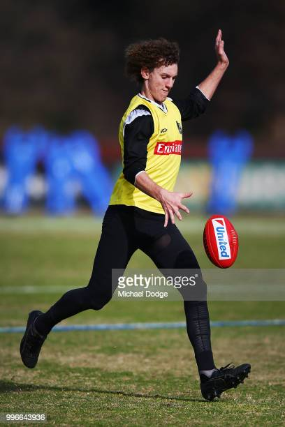 Chris Mayne of the Magpies kicks the ball during a Collingwood Magpies AFL press conference at the Holden Centre on July 12 2018 in Melbourne...