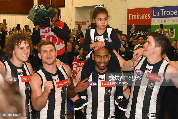 Chris Mayne Taylor Adams Frankie Varcoe Travis Varcoe and Jack Crisp of the Magpies sing the song in the rooms after winning the round 22 AFL match...