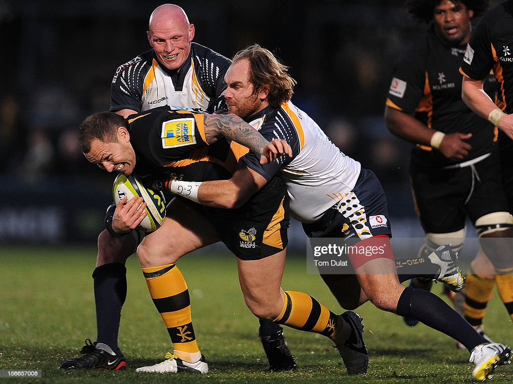 Chris Mayor of London Wasps is tackled by Andy Goode of Worcester Warriors in action during the LV= Cup match between London Wasps and Worcester Warriors at Adams Park on November 18, 2012 in High Wycombe, England.