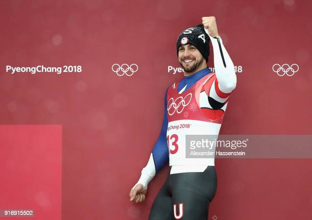 Chris Mazdzer of the United States celebrates at the flower ceremony after winning the silver medal following during the Luge Men's Singles on day...
