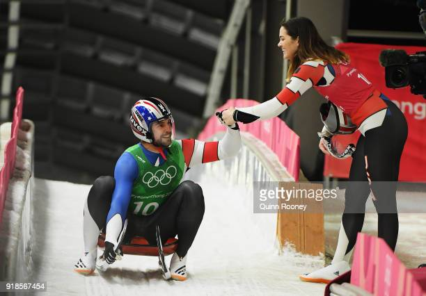 Chris Mazdzer of the United States celebrates with Summer Britcher of the United States after a run during the Luge Team Relay on day six of the...