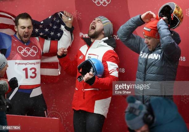 Chris Mazdzer of the United States David Gleirscher of Austria and Johannes Ludwig of Germany celebrate following the Luge Men's Singles on day two...