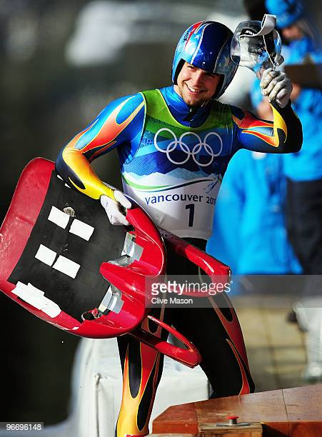 Chris Mazdzer of theUnited States waves to the crowd after his third run of the men's luge singles final on day 3 of the 2010 Winter Olympics at...