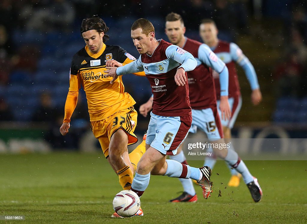 Chris McCann of Burnley holds off a challenge from George Boyd of Hull City during the npower Championship match between Burnley and Hull City at Turf Moor on March 11, 2013 in Burnley, England.