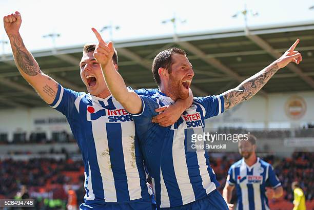 Chris McCann of Wigan Athletic celebrates with Max Power as he scores their first goal during the Sky Bet League One match between Blackpool and...