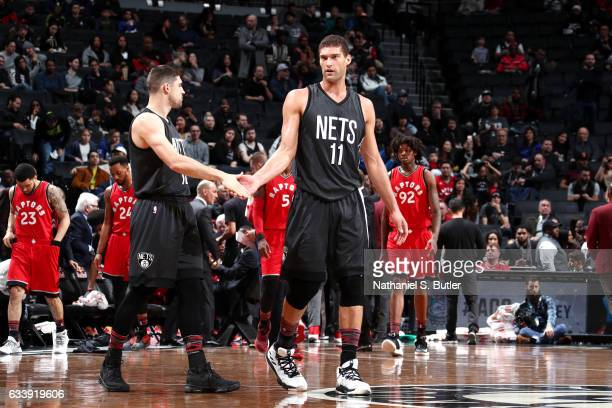 Chris McCullough and Joe Harris of the Brooklyn Nets high five each other during the game against the Toronto Raptors on February 5 2017 at Barclays...