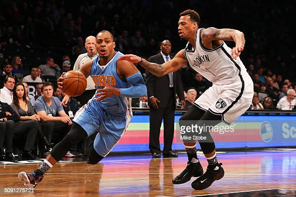 Chris McCullough of the Brooklyn Nets defends against Randy Foye of the Denver Nuggets at the Barclays Center on February 8 2016 in Brooklyn borough...