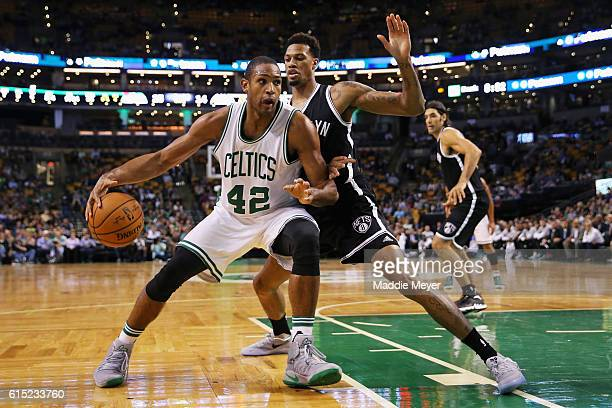 Chris McCullough of the Brooklyn Nets defends Al Horford of the Boston Celtics during the first quarter of the preseason game at TD Garden on October...