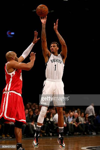 Chris McCullough of the Brooklyn Nets takes a shot as Vince Carter of the Memphis Grizzlies defends on February 102016 at the Barclays Center in the...