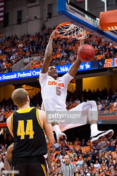 Chris McCullough of the Syracuse Orange dunks the ball in front of Justin Diecker of the Kennesaw State Owls during the first half at the Carrier...