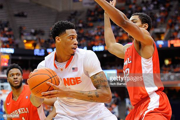 Chris McCullough of the Syracuse Orange looks to pass the ball against the defense of Shonn Miller of the Cornell Big Red during the first half at...