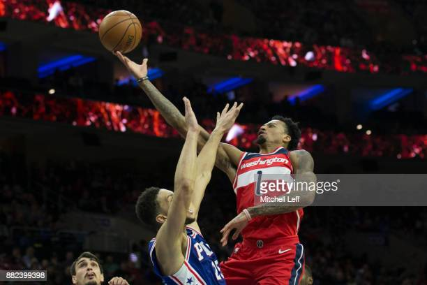 Chris McCullough of the Washington Wizards attempts a shot against Ben Simmons of the Philadelphia 76ers in the fourth quarter at the Wells Fargo...