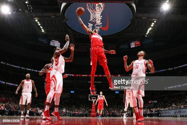 Chris McCullough of the Washington Wizards dunks against the Houston Rockets on December 29 2017 at Capital One Arena in Washington DC NOTE TO USER...
