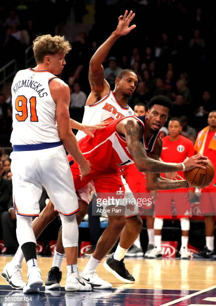 Chris McCullough of the Washington Wizards looks to pass the ball against the New York Knicks in the first half during their Pre Season game at...