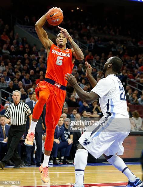 Chris McCullough the Syracuse Orange takes a shot as Daniel Ochefu of the Villanova Wildcats defends in an NCAA college basketball game on December...