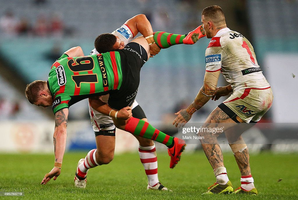Chris McQueen of the Rabbioths is tackled by Bronson Harrison of the Dragons during the round 12 NRL match between the South Sydney Rabbitohs and the St George Illawarra Dragons at ANZ Stadium on June 2, 2014 in Sydney, Australia.