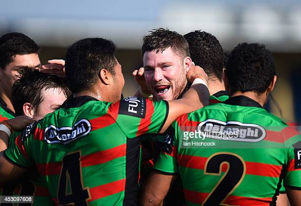 Chris McQueen of the Rabbitohs celebrates after scoring a try during the round 21 NRL match between the South Sydney Rabbitohs and the Newcastle...