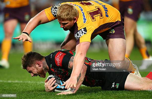 Chris McQueen of the Rabbitohs celebrates scoring a try during the round 23 NRL match between the South Sydney Rabbitohs and the Brisbane Broncos at...