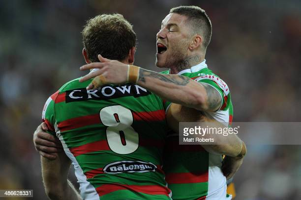Chris McQueen of the Rabbitohs celebrates with try scorer George Burgess during the round 8 NRL match between the Brisbane Broncos and the South...