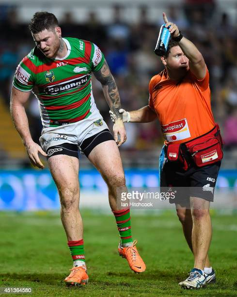 Chris McQueen of the Rabbitohs comes off the field after being injured during the round 16 NRL match between the North Queensland Cowboys and the...