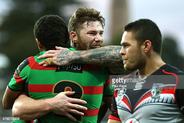 Chris McQueen of the Rabbitohs congratulates Alex Johnston after crossing for a try during the round 13 NRL match between the South Sydney Rabbitohs...