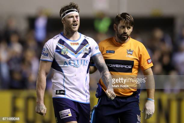Chris McQueen of the Titans leaves the field with an injury during the round eight NRL match between the Cronulla Sharks and the Gold Coast Titans at...