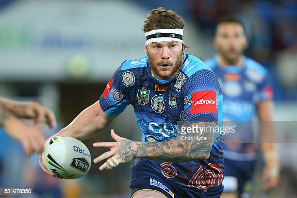 Chris McQueen of the Titans runs the ball during the round 10 NRL match between the Gold Coast Titans and the Sydney Roosters at Cbus Super Stadium...